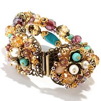 GOLDTONE MULTI STRAND FLOWER CENTER BRACELET