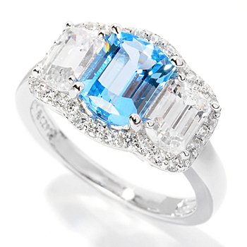 126-599 - Brilliante® Platinum Embraced™ 3.36 DEW Blue Three-Stone Halo Ring